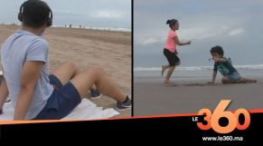 Cover Vidéo -مغاربة يهرعون إلى الشاطئ في أول يوم من تخفيف الحجر