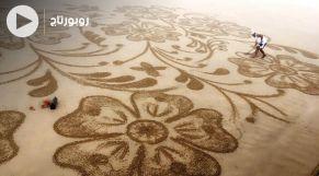 cover: فنان يُحول شواطئ الصحراء المغربية إلى لوحات فنية