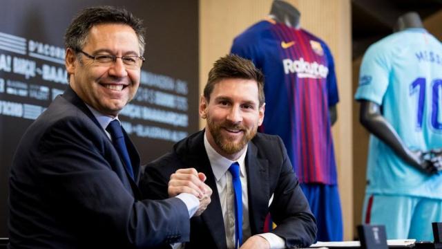 Messi et le président du Barça, J. M, Bartomeu.