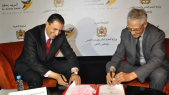 Lahcen Daoudi et Redouane Najm-Eddine, président du directoire d'Al Barid Bank.
